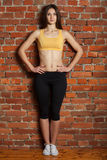 Tion sports woman with beautiful hips against the wall Royalty Free Stock Image