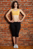 Tion sports woman with beautiful hips and a smile Royalty Free Stock Images