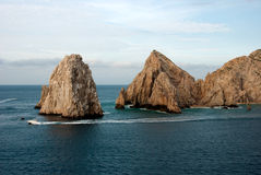 Tip of Baja California. Arch at the tip of Baja California with boat passing by Stock Photo