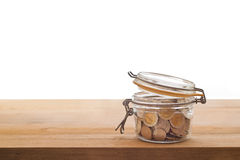 Tip box, coin in the glass jar on wooden Royalty Free Stock Photography
