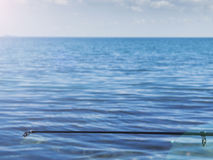 Tip of fishing rod with line outgoing into the sea Stock Photography