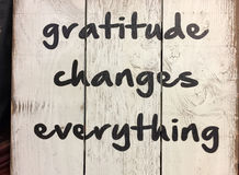 Tip about gratitude. Changes everything print on wood stock photo