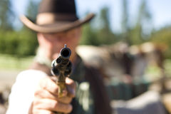 Tip of a Gun. Cowboy aiming gun, focus only on gunpoint Royalty Free Stock Photography