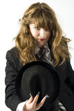 Tip of the Hat. Beautiful young woman tipping her hat to the camera Stock Photography