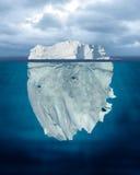 Tip of the Iceberg. Mostly Underwater Iceberg Floating in Ocean royalty free stock image