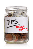 Tip jar. With British currency and label saying thank you stock photos