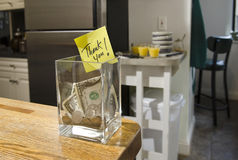 Tip jar in home kitchen Stock Images