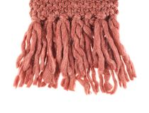 Tip of the knitted scarf Stock Image