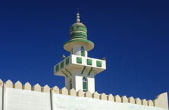 Tip of a minaret. Behind the walls of a mosque, Sur, Sultanate of Oman Royalty Free Stock Photo