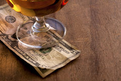 Tip Money. On the wooden counter royalty free stock images