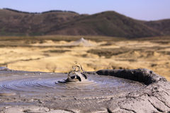 Tip of a mud volcano making bubbles royalty free stock photo