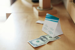 Tip on nightstand maid for clean room Royalty Free Stock Photography