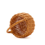 Tip over empty wicker basket on a white background. Inverted empty wicker basket on a white background Stock Photography