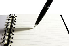 Tip of the pen on note book Royalty Free Stock Image