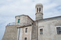 At the tip of the peninsula in Piran is the Church of St. Clement and a lighthouse Stock Photo