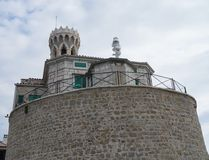At the tip of the peninsula in Piran is the Church of St. Clement and a lighthouse Royalty Free Stock Photos