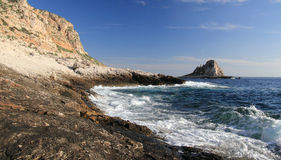 Tip of smooth stones. Levanzo and its coast with the rough sea in Egadi island - sicily Royalty Free Stock Image