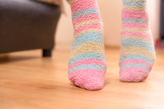 Tip toes. Close up of a person walking on its tip toes, inside bedroom stock images