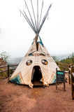 Tipi at Manitou Cliff Dwellings Museum. A tipi also tepee and teepee is a conical tent, traditionally made of animal skins, and wooden poles. Taken at the Royalty Free Stock Images