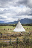 Tipi with storm clouds Stock Photography