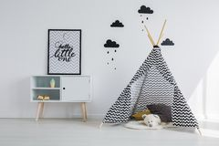 Tipi tent in the room. Tipi tent in the black and white kid room royalty free stock images