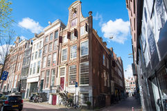 Tipical Amsterdam architecture and narrow street in Amsterdam, Netherlands. Stock Photos