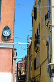 Tipical buildings in Venice,Italy. Old  colorful  buildings with   beautiful   tipical windows   and old clock in  Venice,Italy Stock Photo