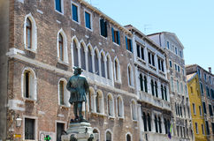 Tipical buildings in Venice,Italy. Old  colorful  buildings and the monument of Napoleon Bonaparte in  Venice,Italy Royalty Free Stock Image
