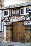 Typical bulgarian antique revival house in Bansko,Bulgaria. Bansko is a town in southwestern Bulgaria, located at the foot of the Pirin Mountains at an elevation stock photography