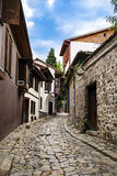 Typical bulgarian stone street with old stone houses. Typical bulgarian rustic empty street in Plovdiv royalty free stock image