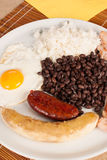 Tipical colombian lunch. Bandeja paisa, a hearty  Colombian lunch Royalty Free Stock Images