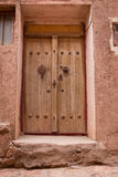 The tipical door of red mud-brick houses in the ancient village of Abyan, in Iran Stock Images