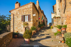 Tipical Old Italian town - narrow street with flowers Stock Photo