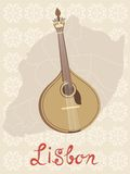 Tipical portuguese fado guitar over Lisbon map and Stock Images