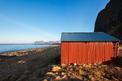 Tipical Red house near the sea coast in Norway Royalty Free Stock Photography