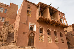 The tipical red mud-brick houses in the ancient village of Abyan Stock Images