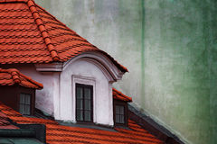 Tipical Red Roof. Loft with red roof and green wall on a backround Royalty Free Stock Image