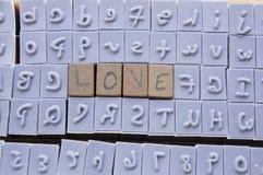 Tipo conceito do alfabeto da letra do selo da palavra das fontes Fotografia de Stock