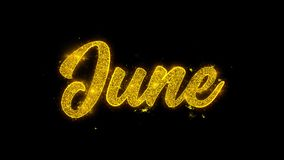 Tipografía de junio escrita con los fuegos artificiales de oro de las chispas de las partículas metrajes