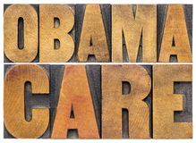 Tipografía de Obamacare en el tipo de madera Foto de archivo