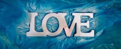 Tipografía del AMOR - apenas muestra blanca pintada en honor del día del ` s de la tarjeta del día de San Valentín Imagen de archivo