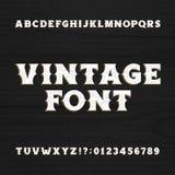 Tipografía del vintage Fuente apenada retra del alfabeto en un fondo de madera ilustración del vector