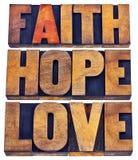 Tipografía de la fe, de la esperanza y del amor en prensa de copiar Imagen de archivo libre de regalías
