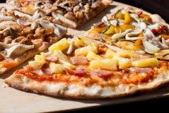 4 tipos de pizza Imágenes de archivo libres de regalías