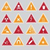 16 tipos etiquetas dos sinais do perigo da cor Fotos de Stock