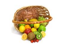 Tipped Basket of Fruit stock photos