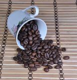 The tipped cup over of coffee Royalty Free Stock Images