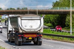 Tipper lorry truck on uk motorway in fast motion.  stock image
