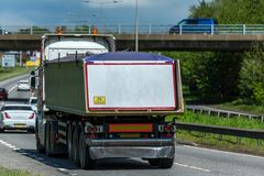 Tipper lorry truck on uk motorway in fast motion.  stock images