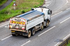 Tipper lorry truck on uk motorway in fast motion.  royalty free stock photography